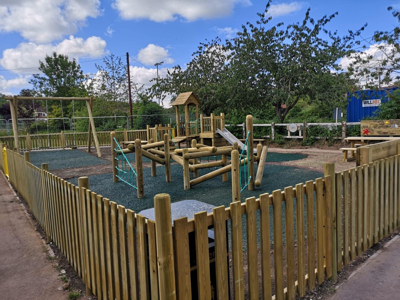 Fencing, play tower, swings and hawks nest
