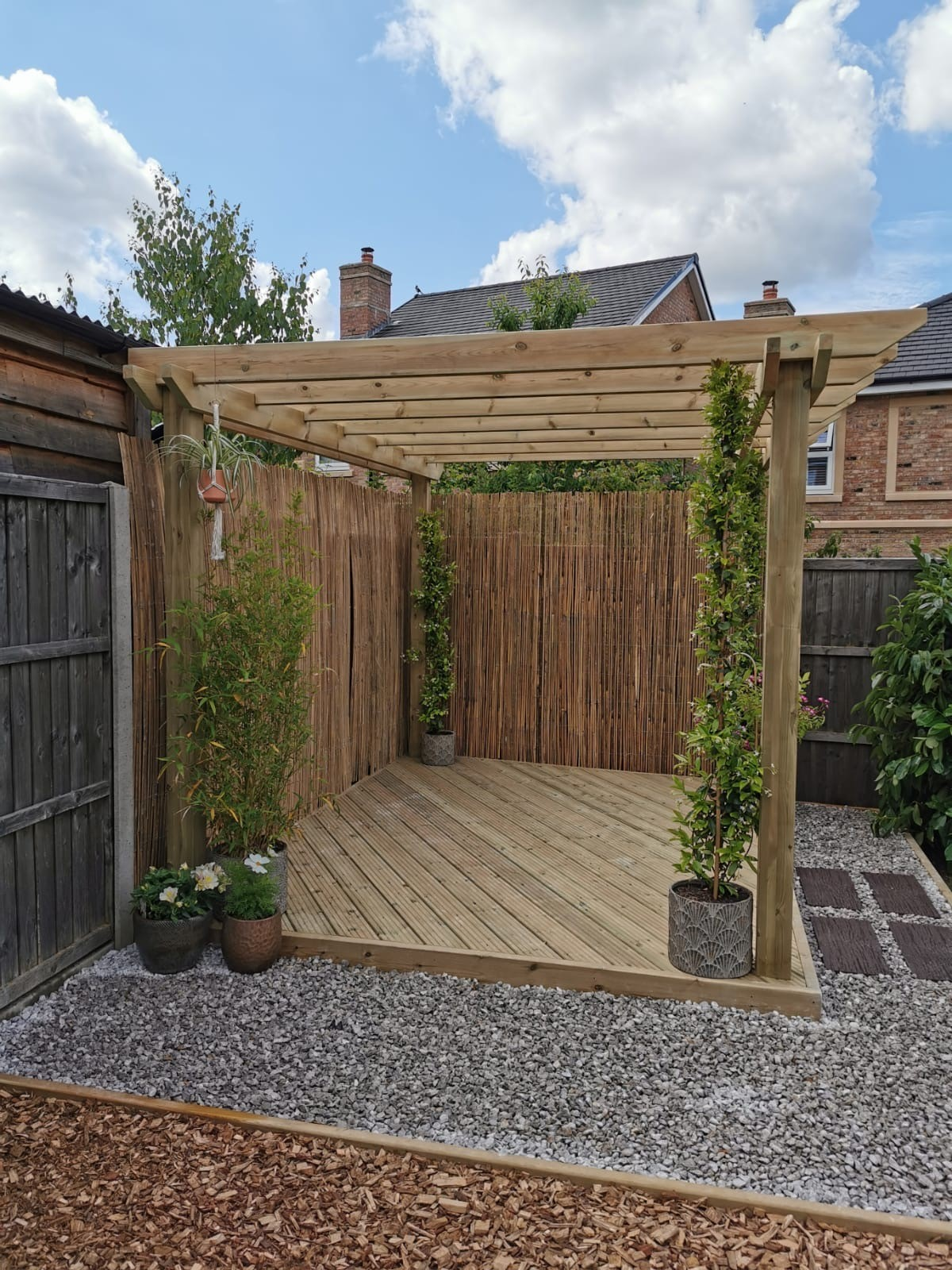 Decked pergola and kids area